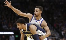 Los Warriors se imponen a Denver con 32 puntos de Curry